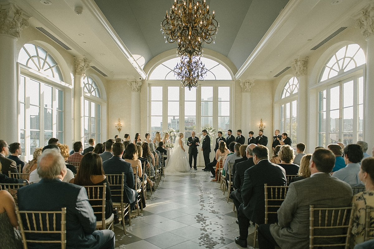 Audrey and Matt say I do in the elegant ball room of Marche in New Orleans.