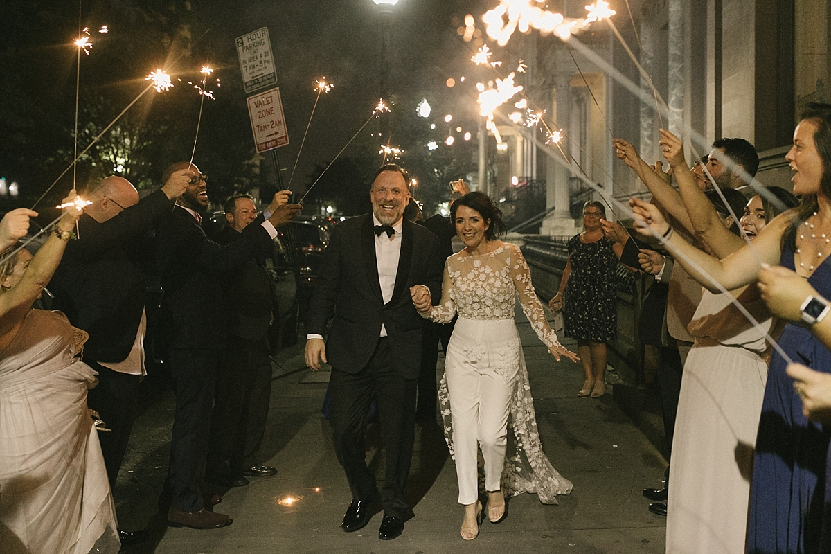Scarlet and Joe celebrate their wedding exit with sparklers, outside of the Baltimore Engineers club.