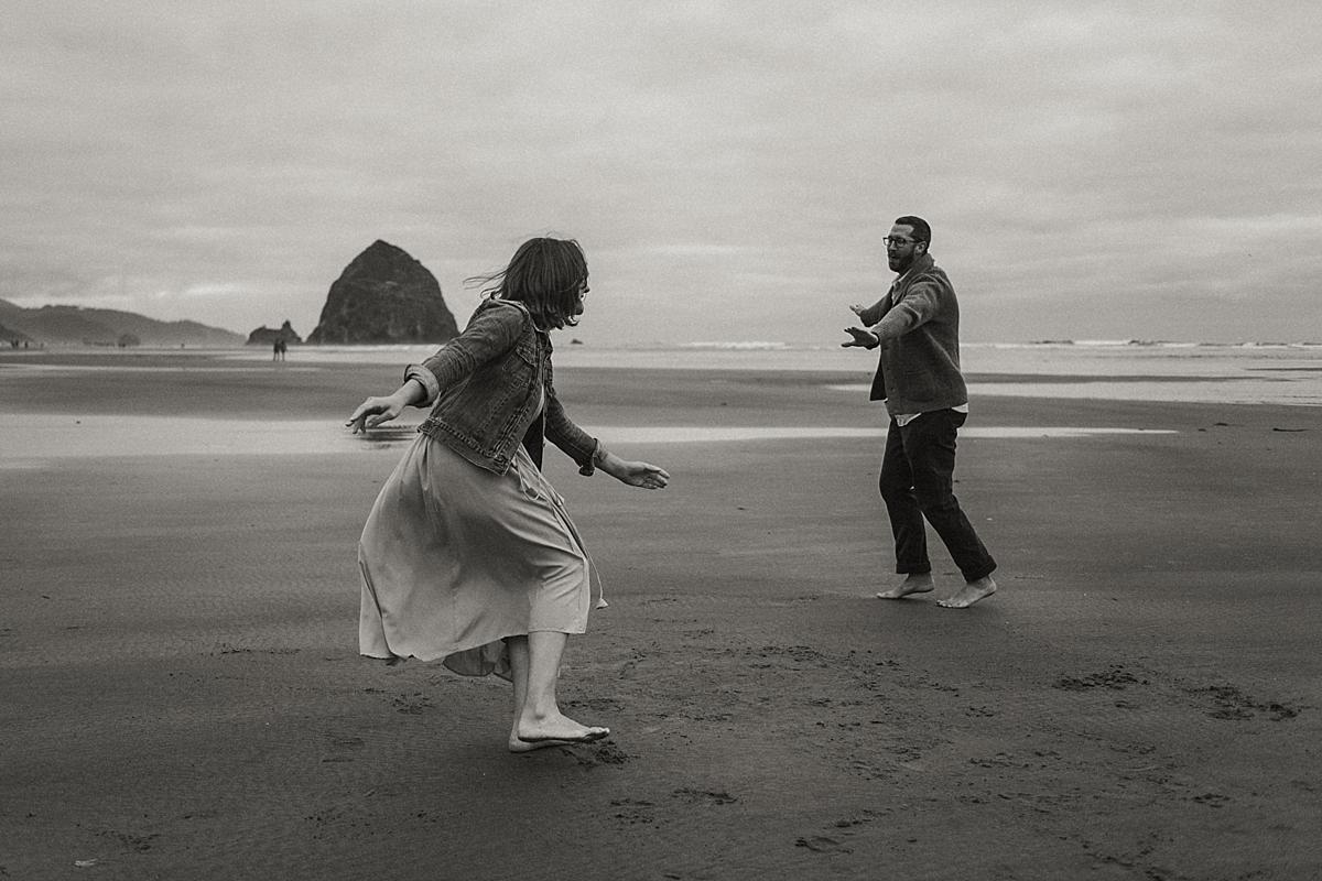 Sarah and Tim spinning around at Haystack Rock