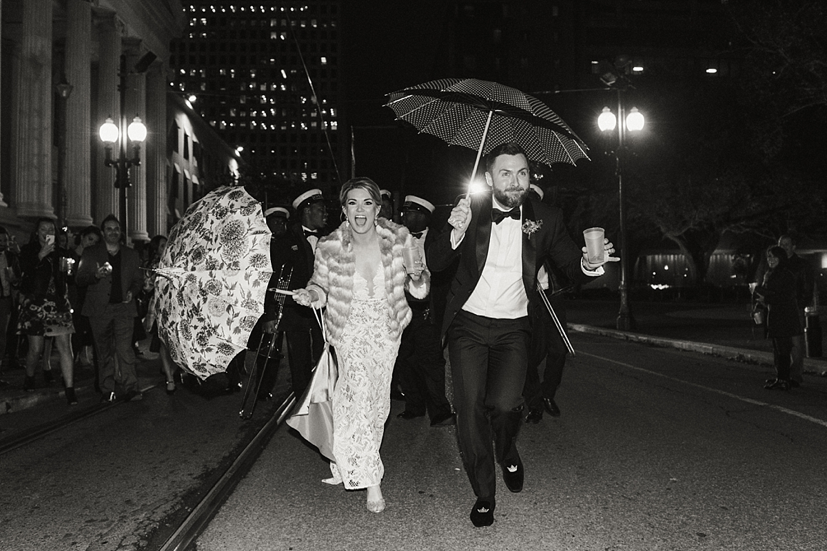 Carol and Charles parading in the streets of New Orleans after saying 'I do' at the Ace Hotel.