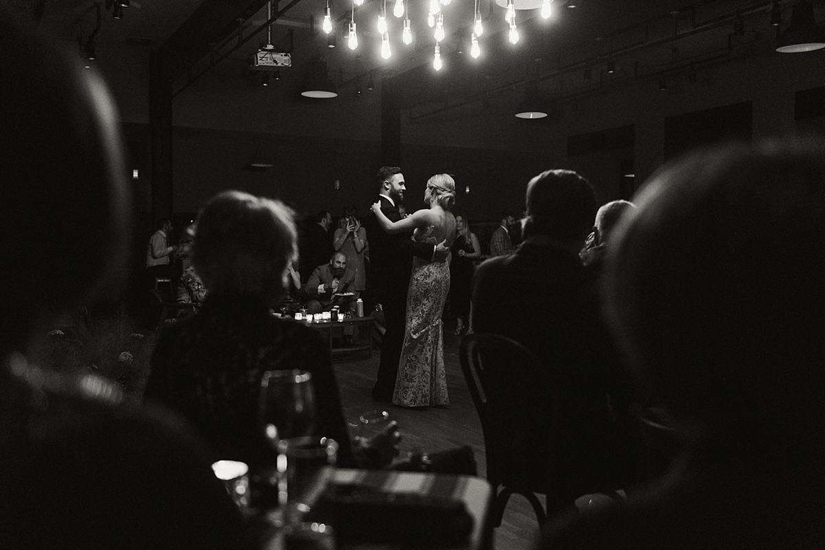 Carol and Charles share their first dance in the ballroom at the Ace Hotel.