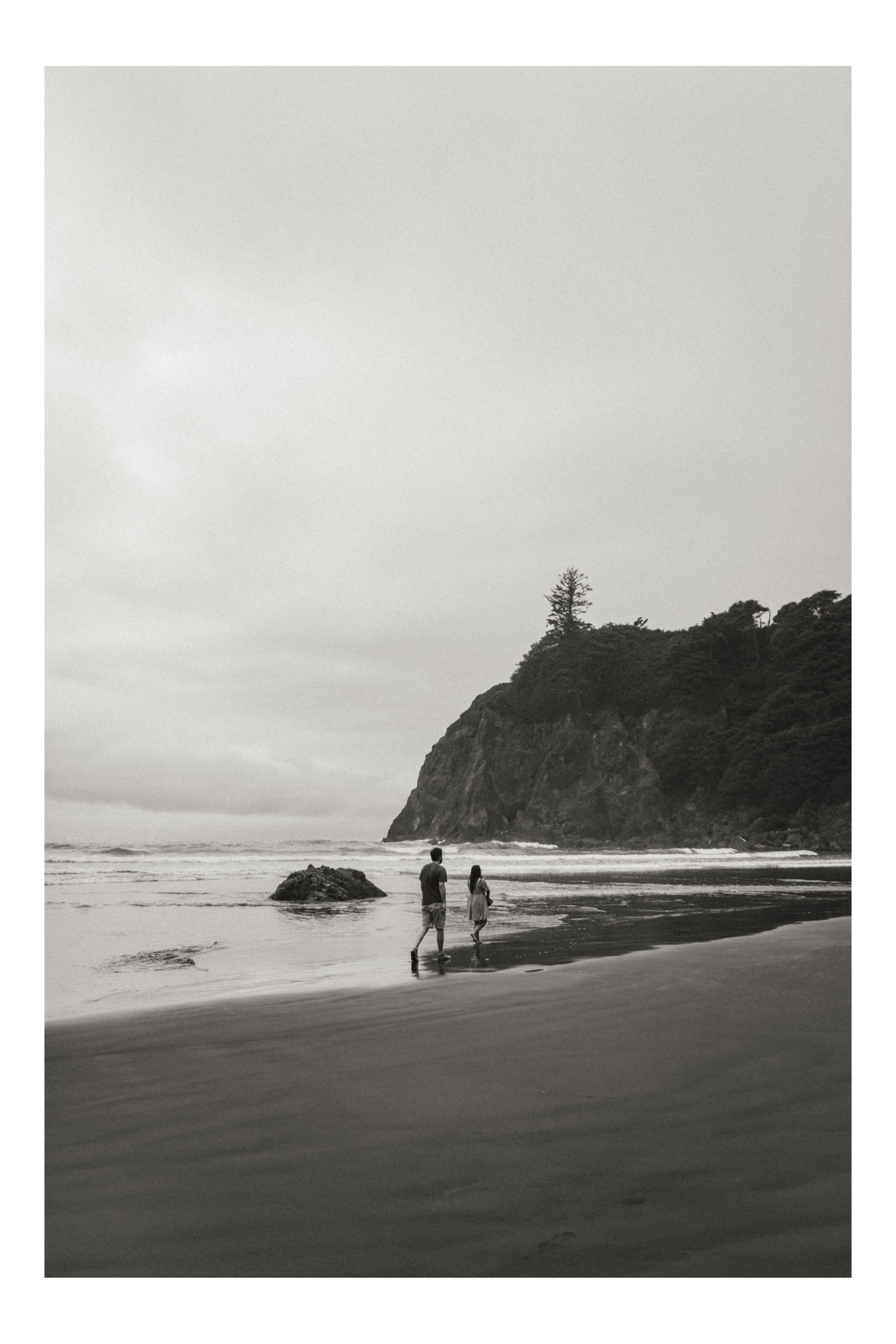 Farrah and Drew walk along a beach outside of Olympic National Park.
