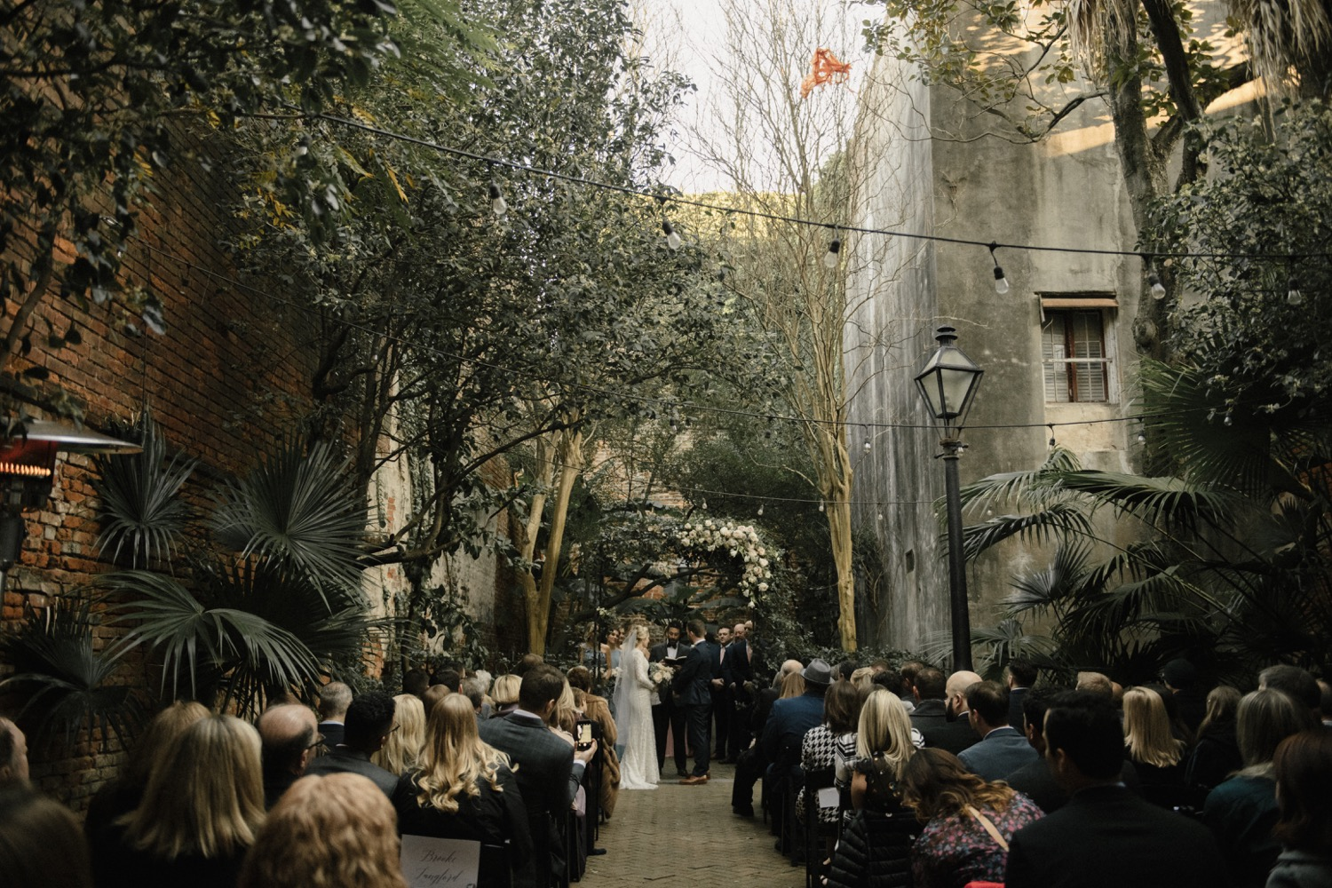 Kirstin and Drew say 'I do' in the stunning courtyard of the Historic New Orleans Pharmacy Museum.