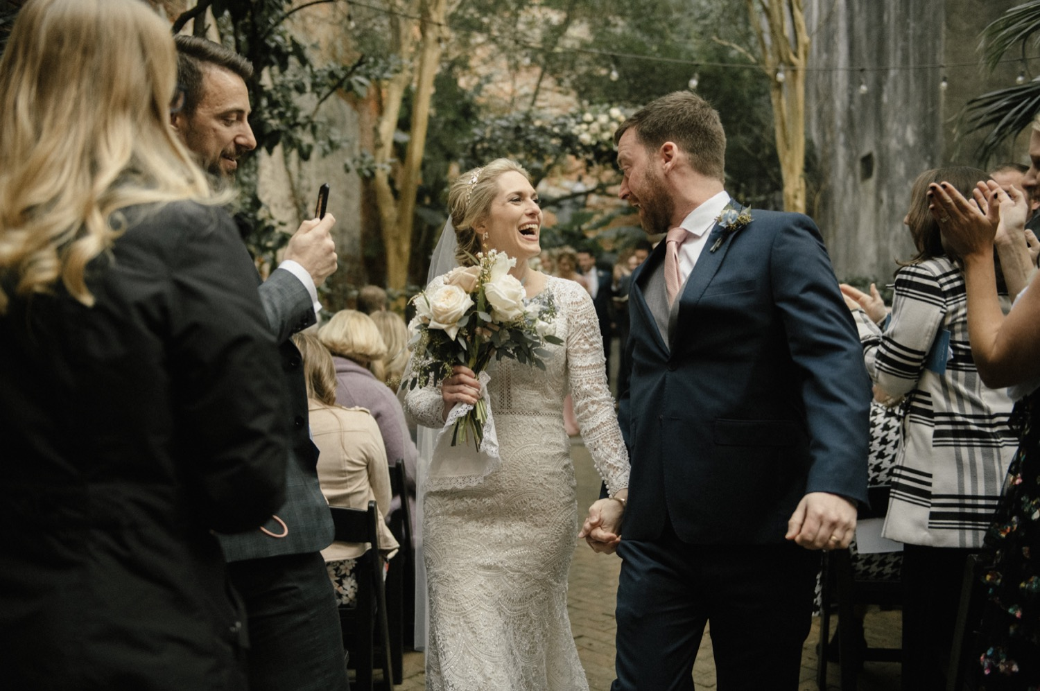 Kirstin and Drew walk down the isle as an officially married couple at the Pharmacy Museum in New Orleans.