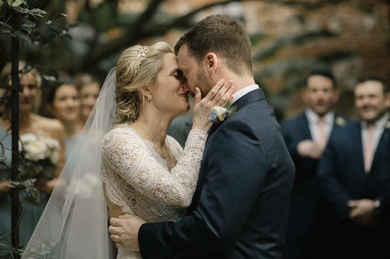 Kirstin and Drew exchange their first kiss at their romantic New Orleans Pharmacy Museum wedding.