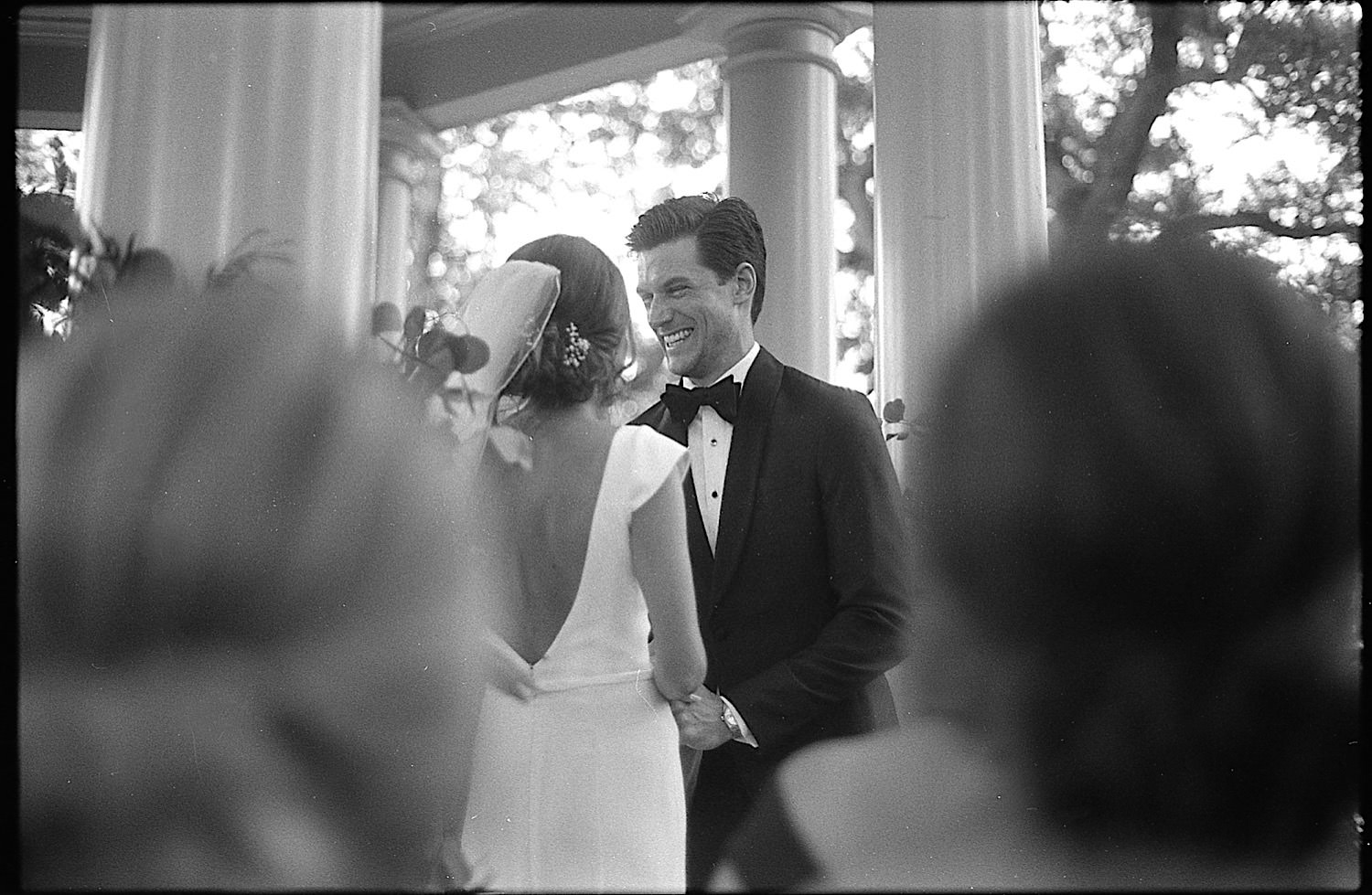Taylor and logan share a laugh at the altar in the courtyard of the Elms Mansion.