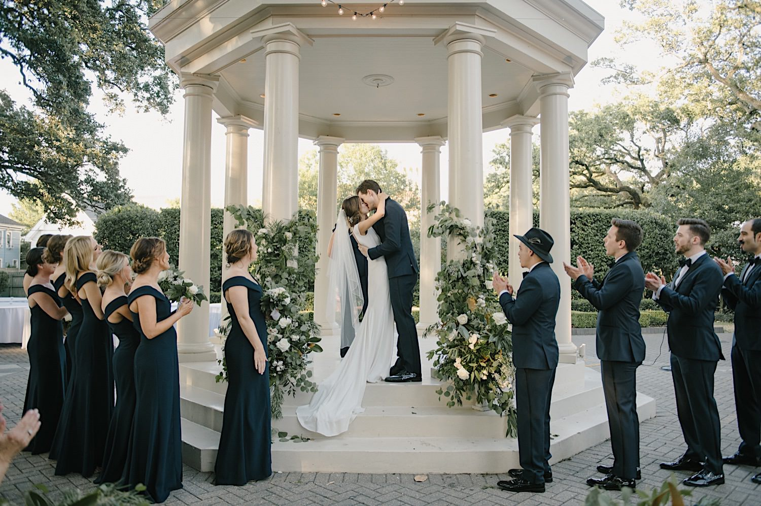 Taylor and Logan seal their ceremony with a first kiss at the Elms Mansion.