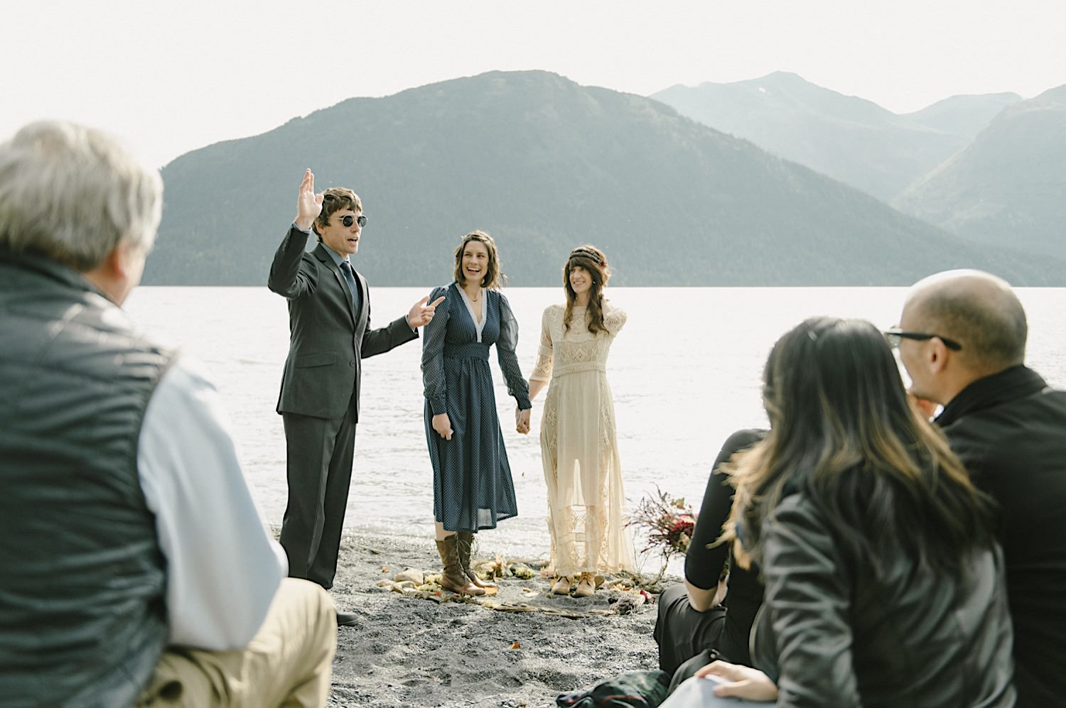 Carol and Julie stand infront of their friends and family as they get married in Alaska, near lake Kenai.