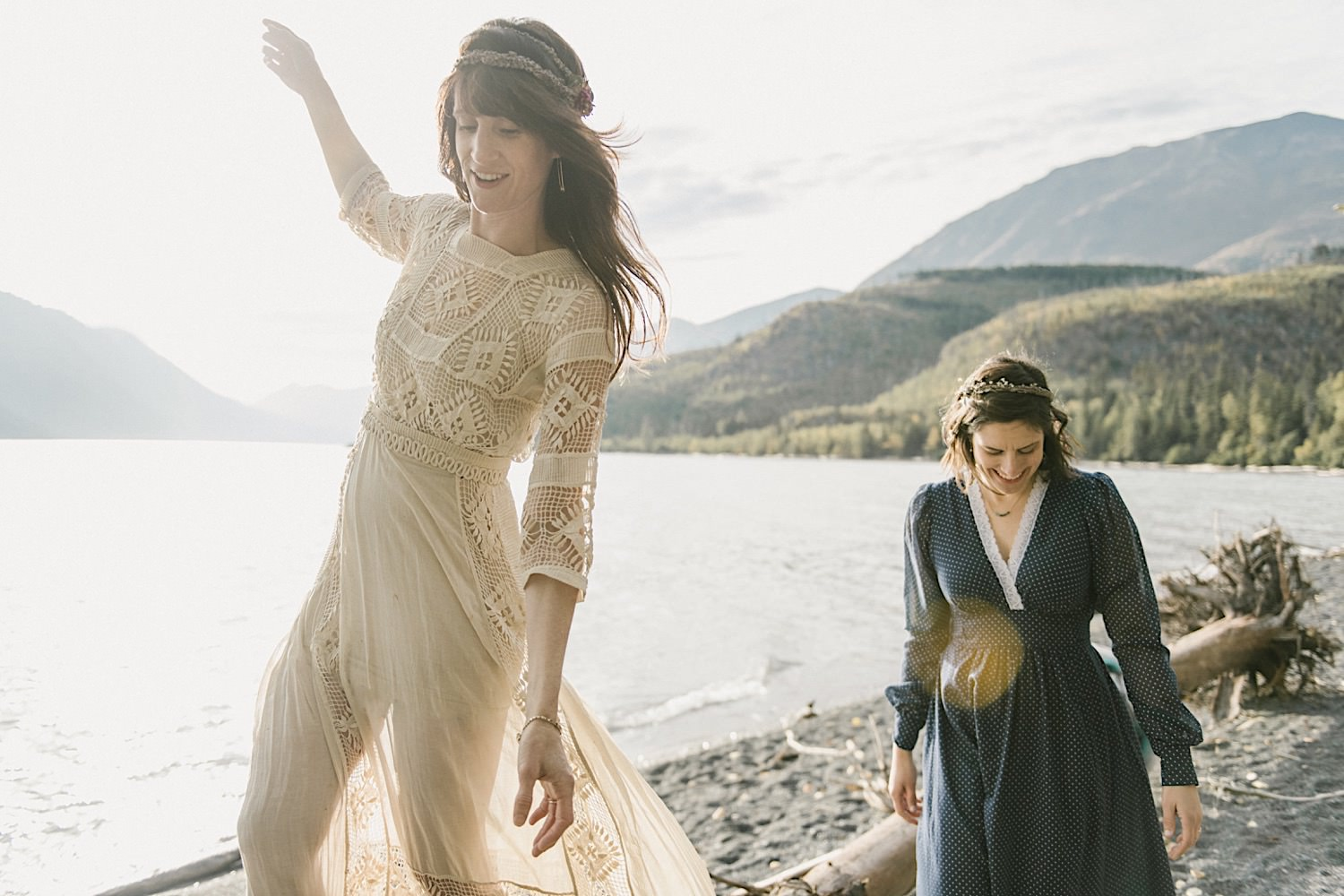 Carol and Julie walk along the coast of Lake Kenai after their intimate Alaska Wedding.