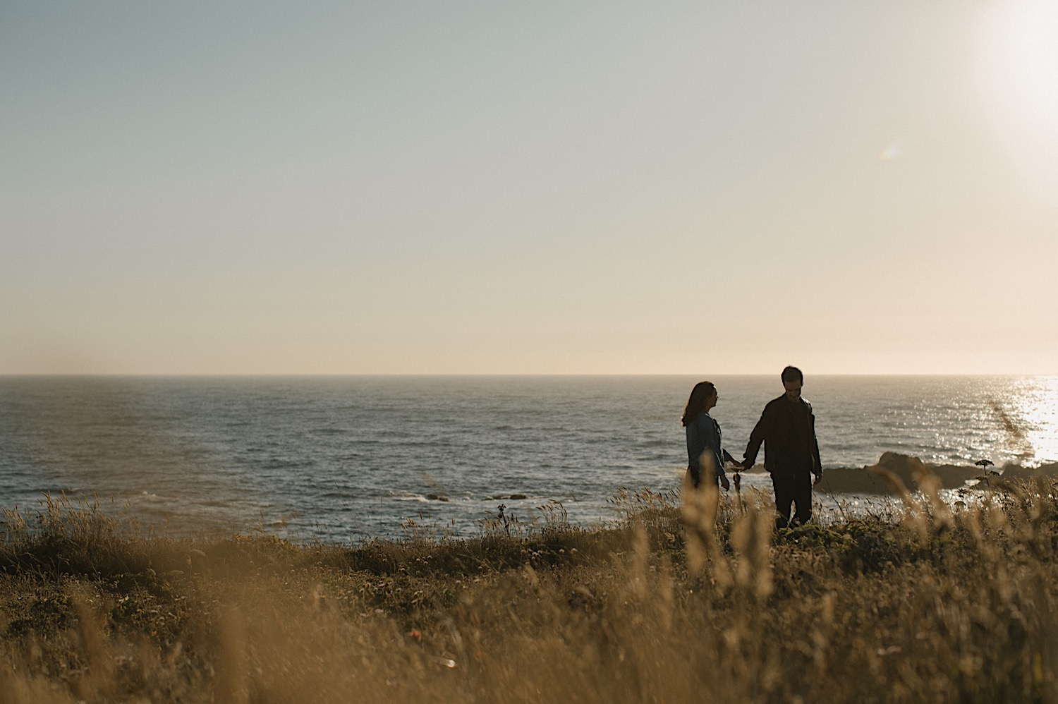 Adam and Vanessa walk along the coast for their Mendocino Engagement Session.
