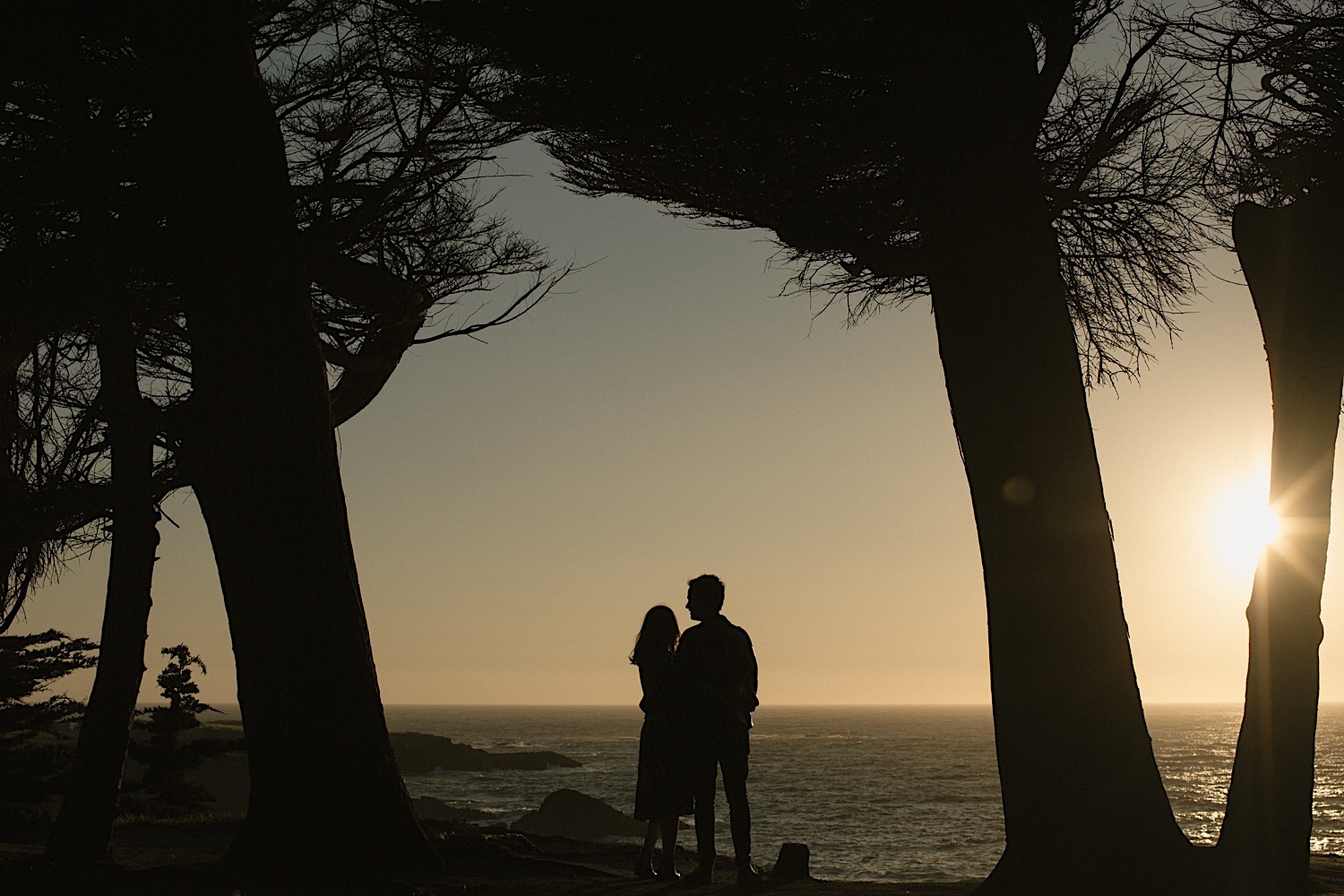 A + V watch sunset at Kelli Point for their Mendocino engagement session.