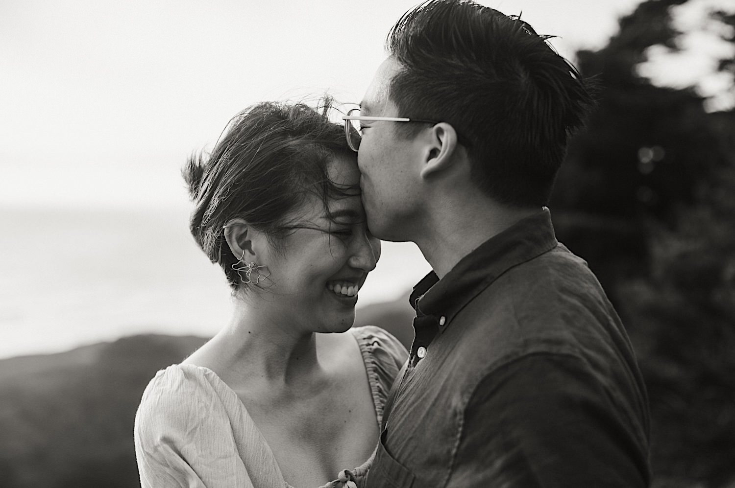 Hanna and Jonathan share a kiss at the beach for their san francisco engagement session.